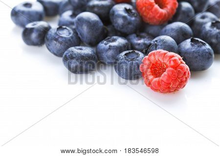Raspberry and blueberry Closeup isolated white background