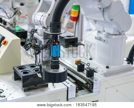 robot arm with Visual measuring system,Smart factory industry 4.0 concept.