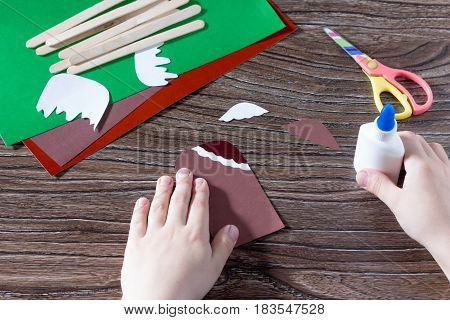 The Child Glues The Details Of The Craft. Creates A Child The Gift Of Paper Popsicle. Made By Hand.