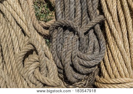 rope pattern formed by different colors of worn intertwined strings