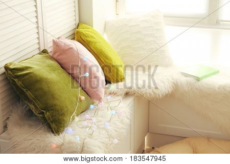Comfortable place for rest near window in modern flat