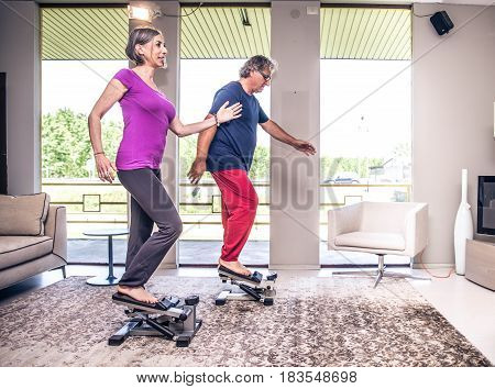 Retired people at exercise fitness activity in gym living room
