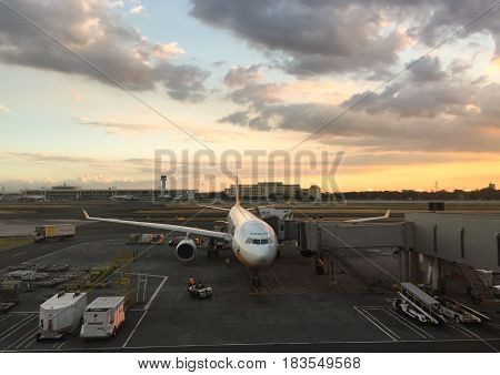 Airplane At The Airport In Sunset