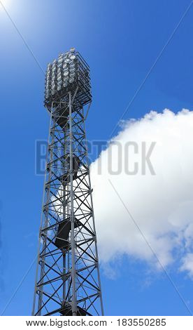High searchlight tower installed at the stadium. Against a clear sky