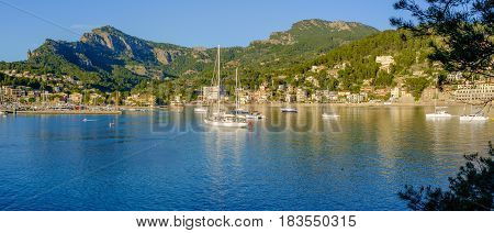 Panoramic view of boats moored in the bay at Port de Soller Majorca, Spain (21x9)