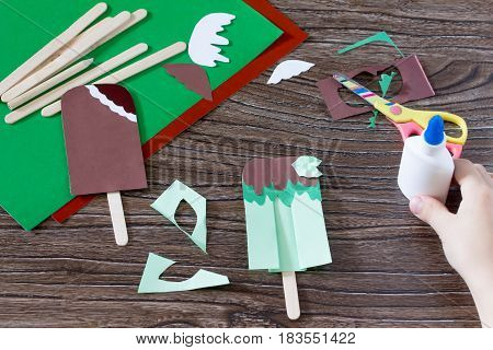 The Child Glues The Paper Details Of The Craft. Creates A Child The Gift Of Paper Popsicle. Made By