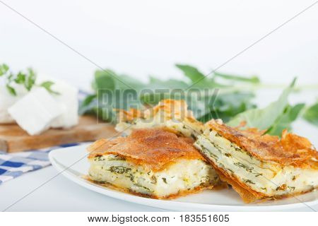 Plate of Freshly baked Serbian Traditional Zeljanica Spinach-cheese Pie slices