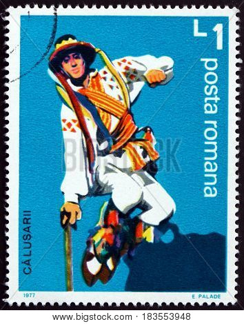 ROMANIA - CIRCA 1977: a stamp printed in Romania shows Romanian Male Folk Dancer Calusarii circa 1977