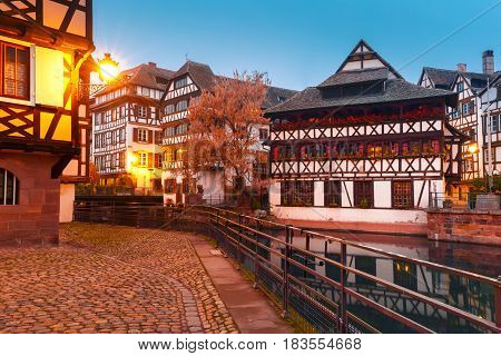 Traditional Alsatian half-timbered houses in Petite France during morning blue hour, Strasbourg, Alsace, France