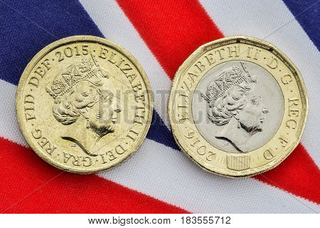 Comparison Of Old And New British Pound Coins. Heads.