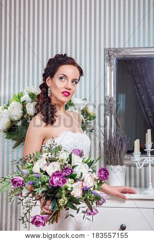 Beautiful Bride portrait wedding makeup and hairstyle .Young attractive bride with flowers