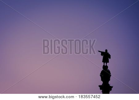 Christopher Columbus statue silhouette over sunset and blue hour clear sky. This is one of the iconic images of Barcelona. Suitable for Columbus day