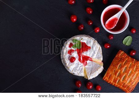 Melted Camembert Cheese With Cranberry Sauce