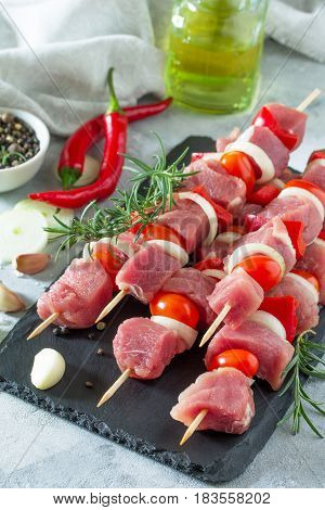 Fresh Meat Kebab. Meat Fillet Raw With Cherry Tomatoes, Onions, Spices And Rosemary On A Cutting Boa