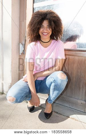 Cheerful Black Mixed Woman In Street Fashion