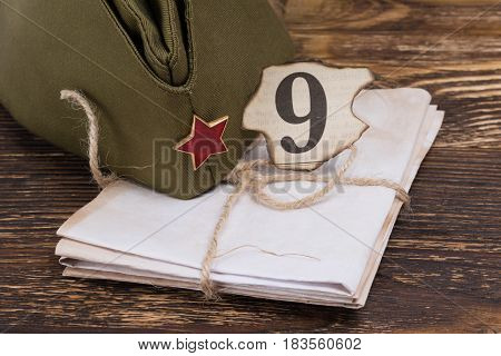 Letters from the front on a wooden table background to the day of victory