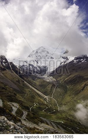 Mountain Pass In Huascaran National Park, With Huascaran Mount At Background. Cordillera Blanca. Per