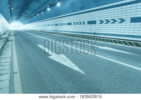 Abstract speed motion in urban highway road tunnel, blurred motion.