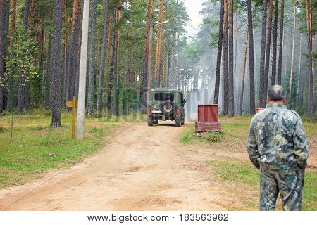 man walks in forest, a jeep in forest