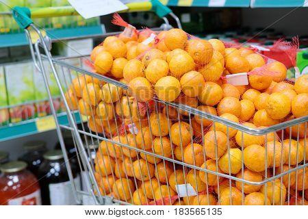 Mandarins in a trolley in a shop