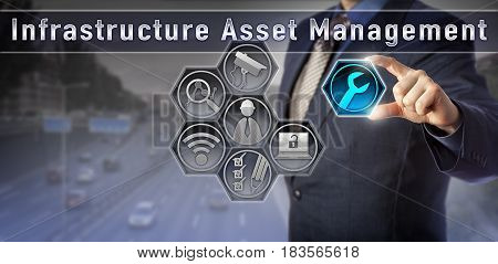 Blue chip engineering manager is initiating maintenance operations via a virtual Infrastructure Asset Management control matrix. Technology and business concept for sustaining public infrastructure.