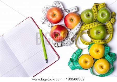 Healthy Eating: Fresh Apples, Measuring Tape And Notepad On White Table.