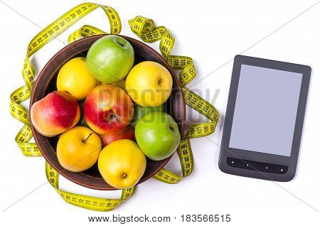 A Plate Of Fresh Apples, A Measuring Tape And A Tablet, Against A Light Background.