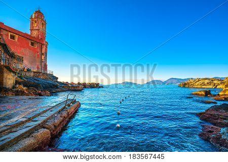 Tellaro sea village church and buoys. Five lands Cinque Terre Liguria Italy Europe.