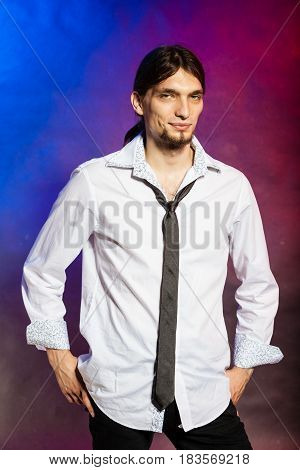 Masculinity fashion party concept. Man in shirt and tie. Young long haired male on bright colorful background.