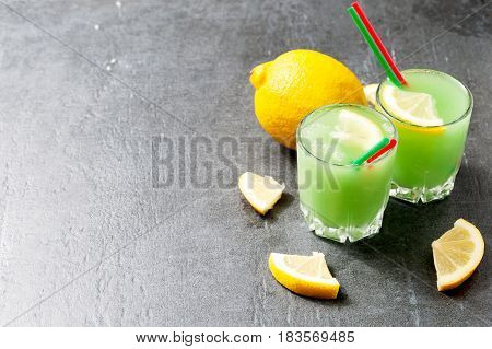 Lemon Coctail Drink. Lemonade In Two Glass And Lemon On The Table