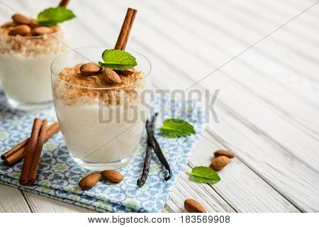 Creamy Rice Pudding Topped With Cinnamon And Almond