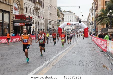 Rome Italy - April 2 2017: Athletes of the 23rd Marathon of Rome at the passage in Via Nazionale a few kilometers from the finish line.