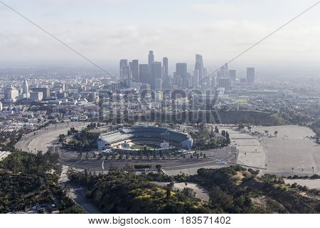 Los Angeles, California, USA - April 12, 2017:  Aerial view of the historic Dodger Stadium with hazy downtown towers in background.