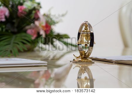 Bell decoration on the glossy table on the background colors
