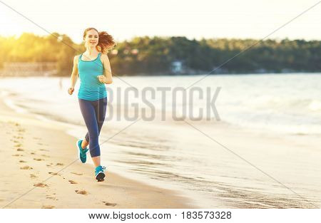 woman goes in for sports jogging on the beach