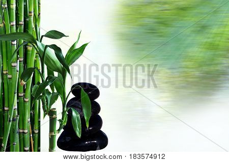 Black stones in balance and bamboo zen concept