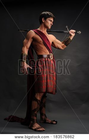 The buff highlander is showing off his sword.