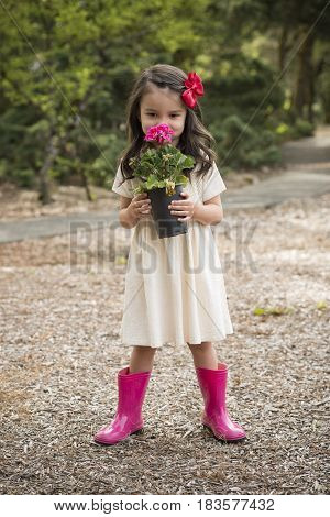 Little Hispanic Girl With Flowers