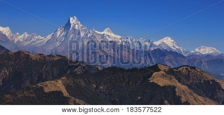 Fish tail mountain Machapuchare and other mountains of the Annapurna range on a autumn day. View from Mohare Danda Nepal.