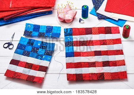 Square pieces of fabrics selected and stitched like a flag of USA