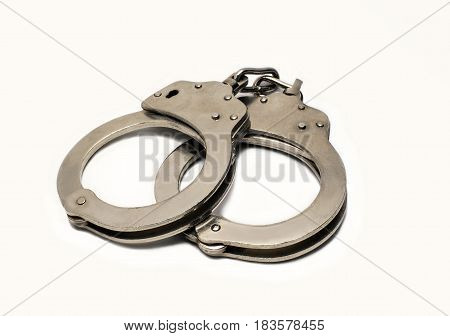steel handcuffs lying on a white background