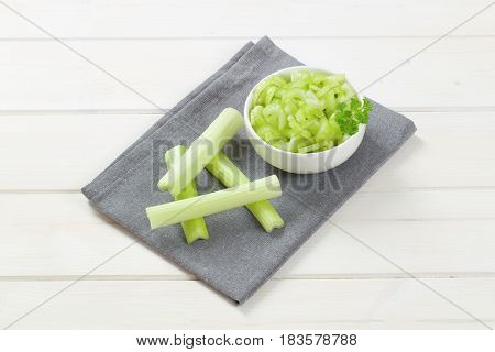 bowl of chopped celery stems on grey place mat