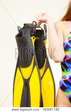 Woman In Swimsuit Holds Flippers