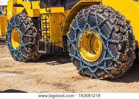 Bulldozer Oversize Snow Tires With Chains In Springtime