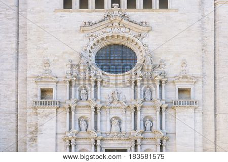 Church wall with round window in Girona Spain