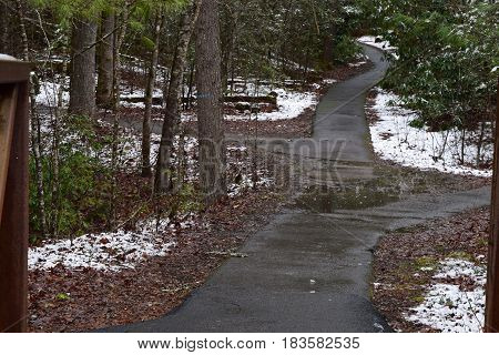 Fires Creek park path in early Spring with a snow dusting.