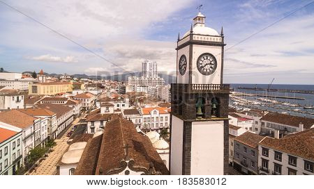 Saint Sabastian church with clock tower in Ponta Delgada on Sao Miguel Island in Azores, Portugal. Beautiful church in early morning under white clouds.