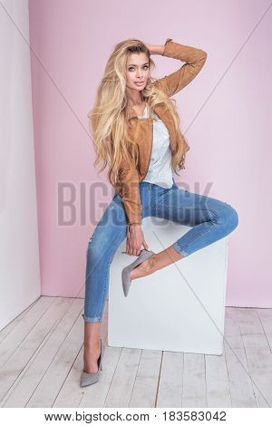 Fashionable Blonde Woman On Pink Background.