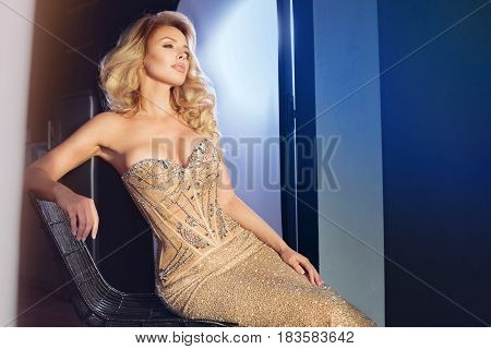 Sexy Blonde Woman In Elegant Dress.