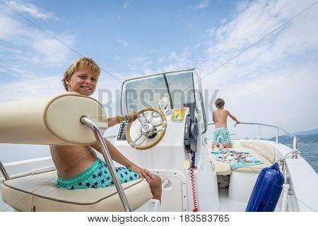 boys in a boat at lake garda italy